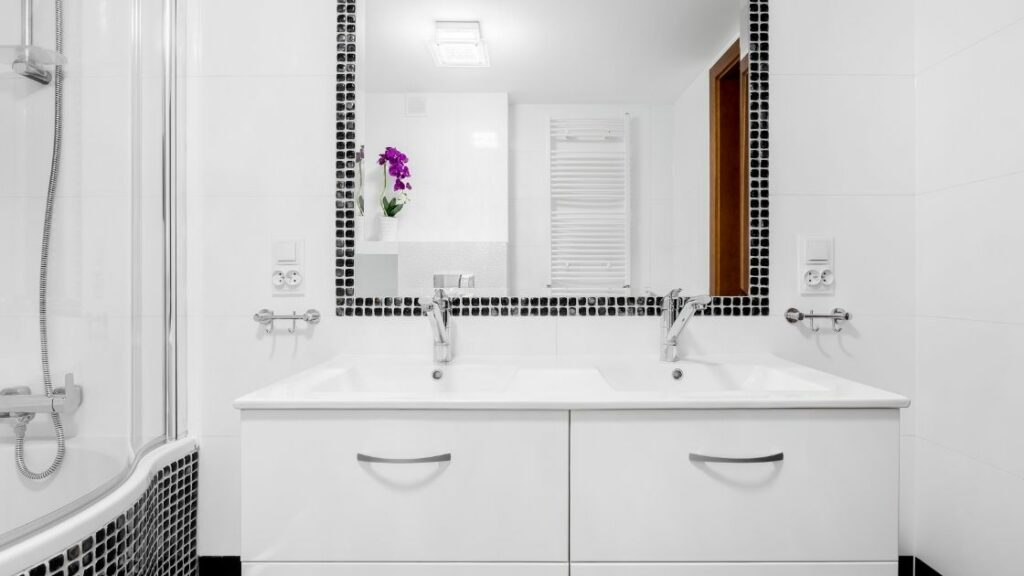 White bath with black tile