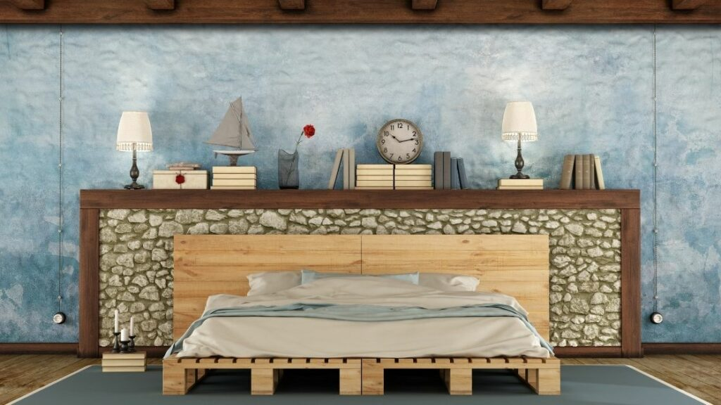 Set against the stone half-wall, the simple pallet style bed frame adds to the nautical feel.