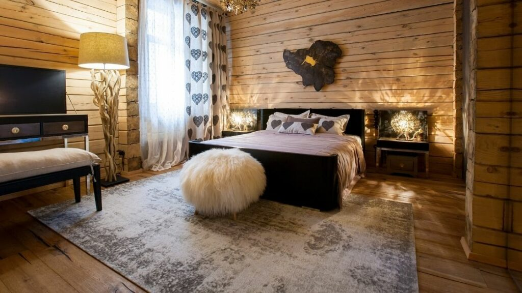 There is wood everywhere in this rustic bedroom