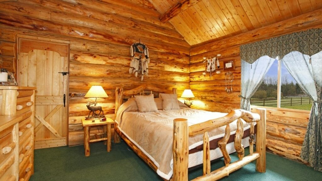 Here we have another tremendous wooden bed.  This room looks like something out of a fairy tale.  Everything is slightly irregularly shaped from the bed to the bedside tables and dresser.
