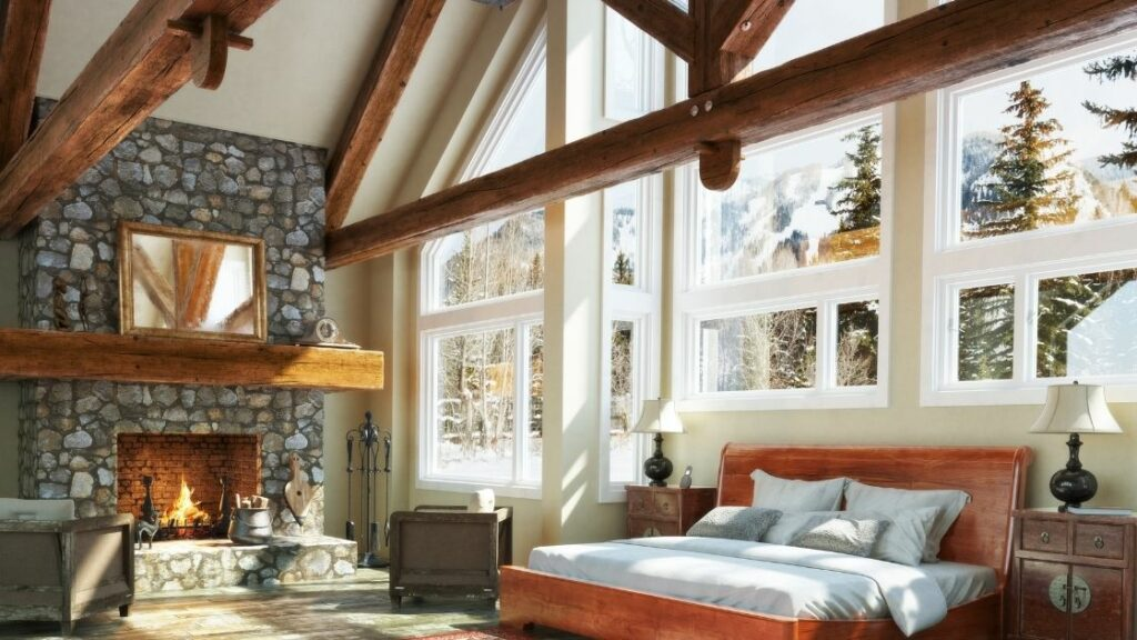 The large cherry wood beams and stone fireplace make this a lovely bedroom.