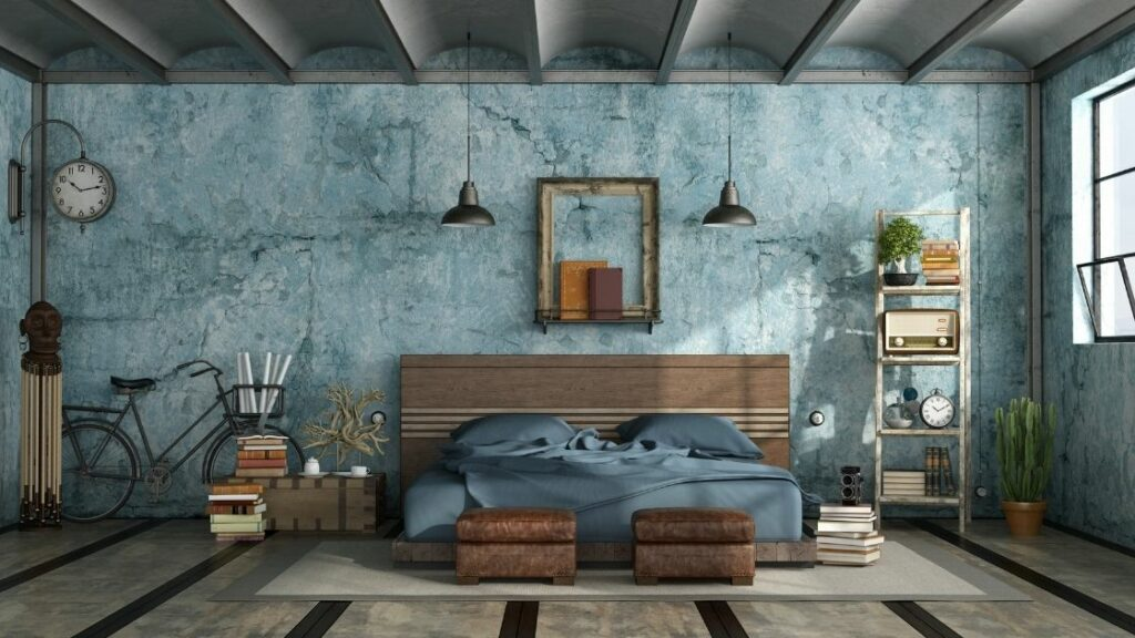 Bathed in natural light, this loft bedroom has a beautiful cool blue color theme, and the vintage decorations add to the rustic feel.